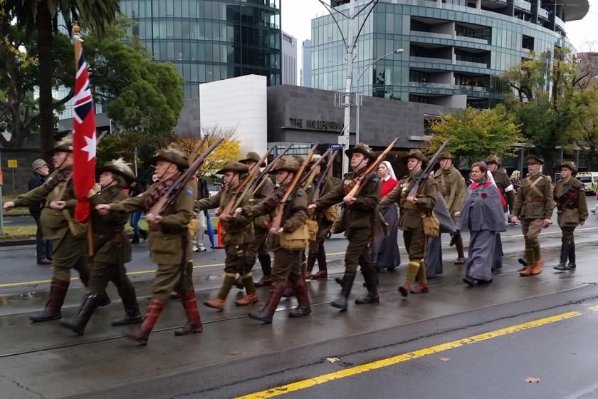 Some groups are a mixture of both, displaying the historic uniforms as they march along.
