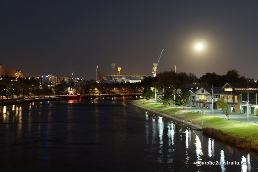 The other side of the river has less skyline, but more moon. And cricket / footy stadium.
