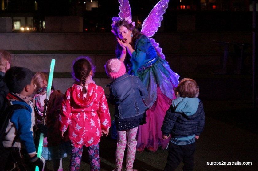 A fairy was telling fantastic stories to the kids, while the parents lined up at the coffee bus.