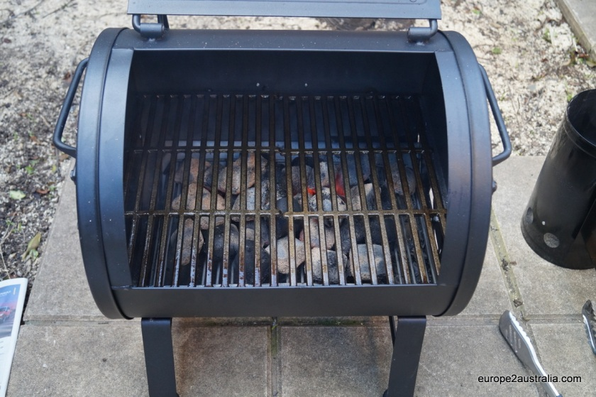Since it's a new BBQ with an cast-iron grate, it needs some seasoning: pre-heating it in a coat of vegetable oil.