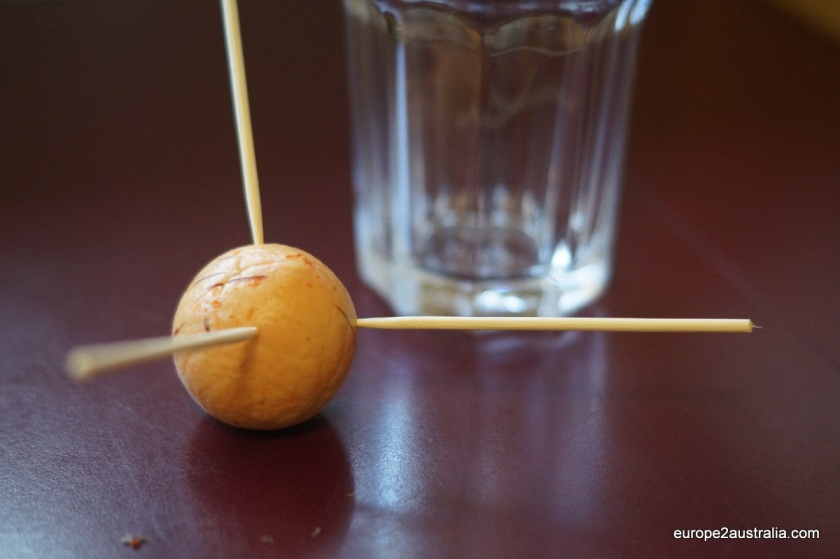Step 3: Insert three toothpicks at an angle into the top of the pit.