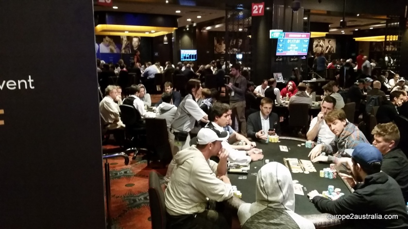 The low room was full of poker tables, with a lot of very serious people sitting around them.