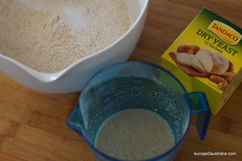 Add two satchels of dired yeast (7g per satchel) and a tablespoon of brown sugar to half a cup of lukewarm water.