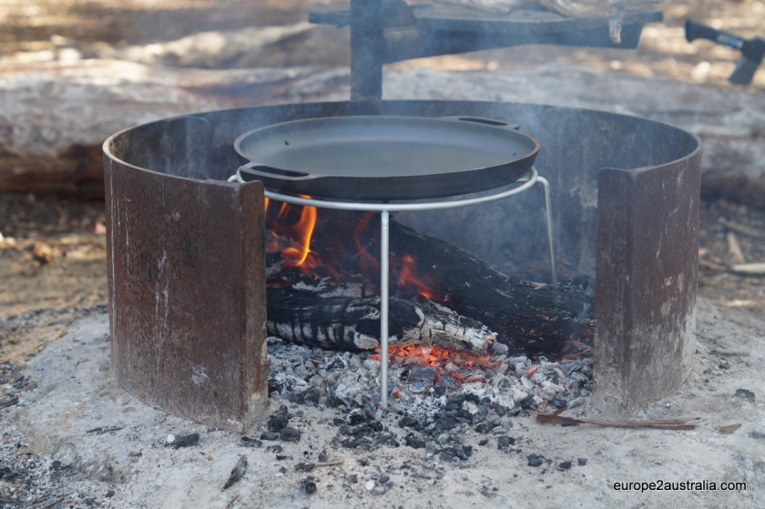 Build a fire. Place your steel pan above it to pre-heat.