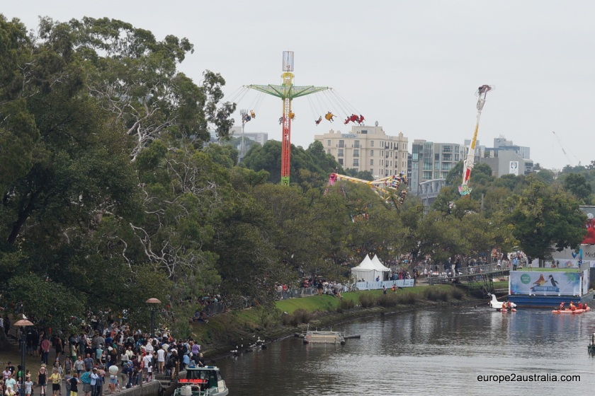 A large part of the area is given over to carnival rides. The north shore of the river is dominated by the very high machines.