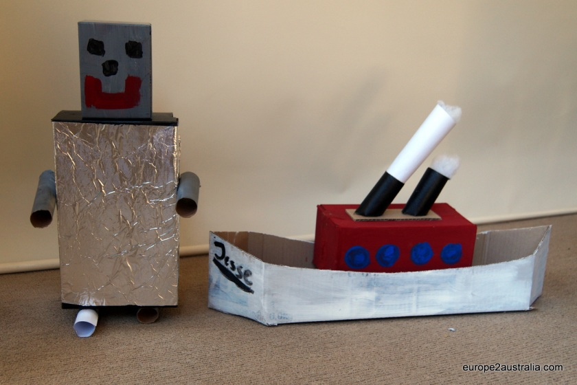 A few cardboard boxes, some glue, some paint and aluminum foil make an awesome boat and a robot.
